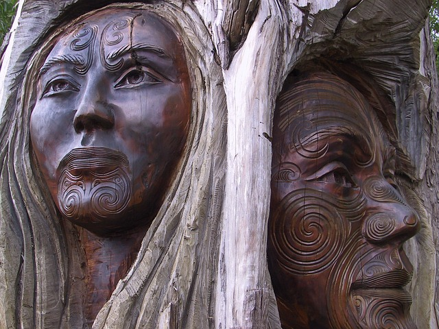 harness your intuition wood carvings of man and woman