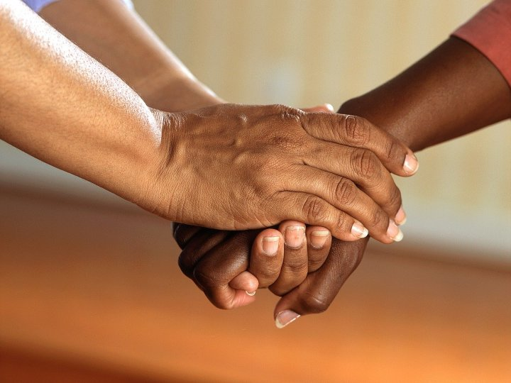 person holding another person's hand: comfort words for someone who is mourning