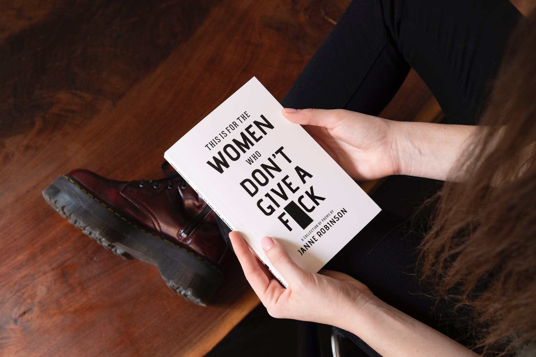 woman sitting holding a book